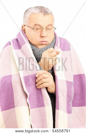 Senior man covered with blanket and neckwear coughing because of pulmonary disease isolated on white background