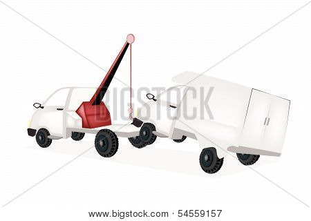 Wrecker Tow Truck Pulling A Car After An Accident