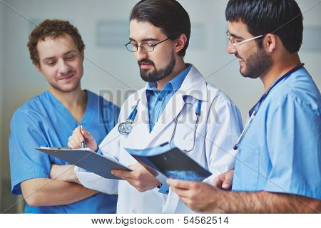 Portrait of three clinicians in uniform working in team