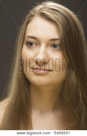 Portrait Of Girl Of Blonde  With Long Direct Hairs