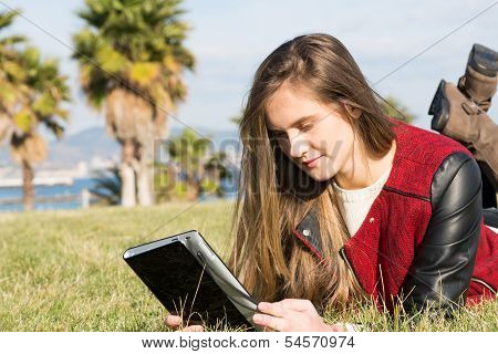 Young Girl With A Tablet