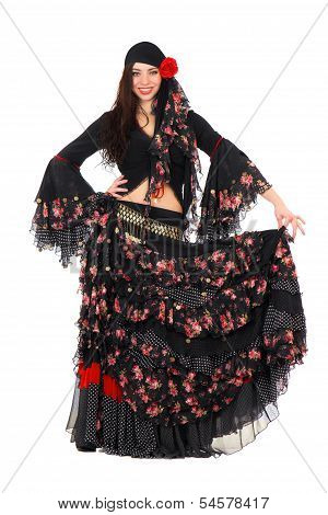 Cheerful young woman wearing romany traditional costume. Isolated on white poster