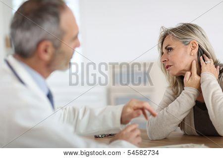 Senior woman feeling neck pain
