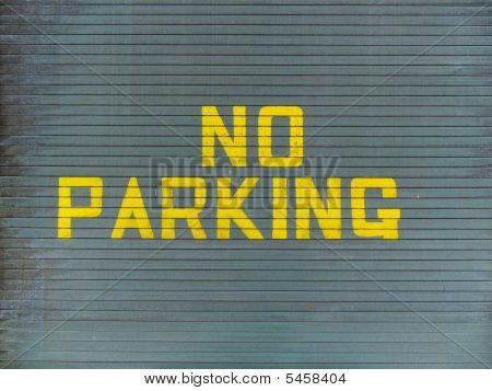 No parking painted on a metallic garage door poster