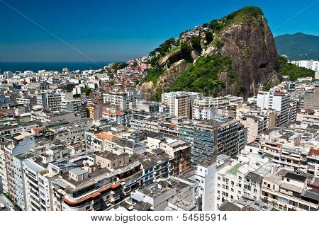 Aerial view of Copacabana district with Cantagalo slum on the mountain in Rio de Janeiro, Brazil. poster