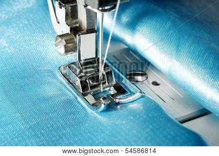 Sewing machine with blue cloth closeup