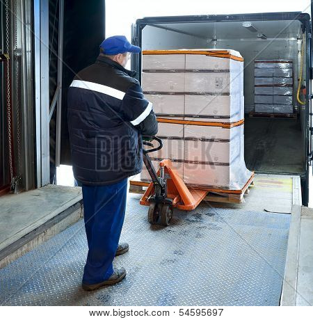 Worker Loading On Truck