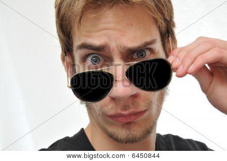Handsome Man Taking Aviator Sunglasses Off