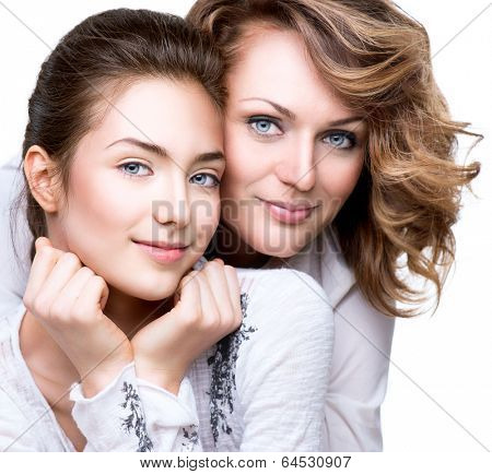 Mother and Teen Daughter. Close-up portrait of attractive happy mother and smiling teenage daughter. Teenager girl with her mom smiling. Happy family concept
