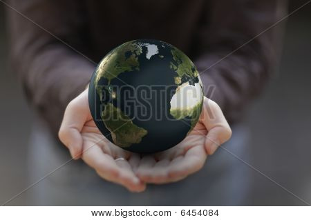 Man's Hands Holding a Globe
