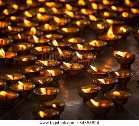 Burning candles in Buddhist temple. Tsuglagkhang complex,  McLeod Ganj, Himachal Pradesh, India