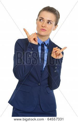 Portrait Of Clueless Business Woman Pointing