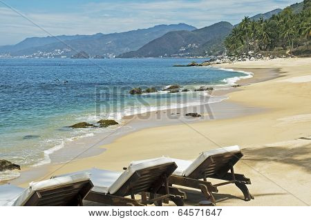 Tranquil Beach With Lounge Chairs