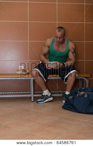 Bodybuilder Eating Healthy Bodybuilding Diet Food Out Of Tupperware poster