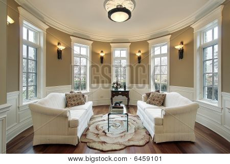 Living room in luxury home with lighting scones poster