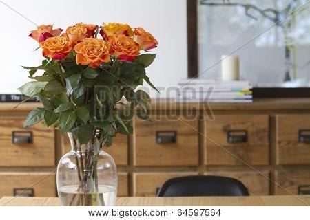 Orange Roses On Dining Table Interior Scene