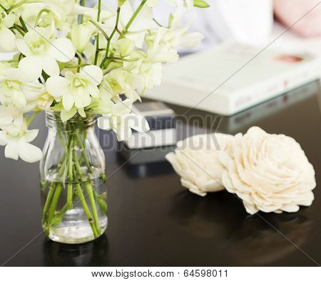 Orchids In Vase On Pretty Bedside Table Square