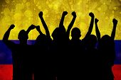 Silhouettes of football supporters against colombia flag in grunge effect poster