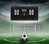 Black scoreboard with no score and football against football pitch in large stadium poster