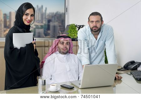 Multiracial Business Meeting in office , arabian businessman & arabian Secretary wearing hijab & a Foreigner meeting in office poster