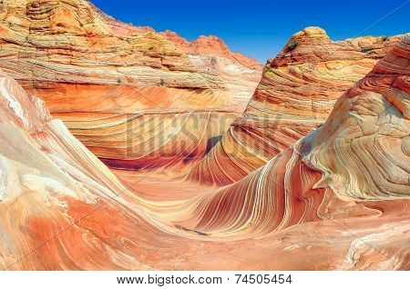 Mountains from red sandstone in the form of ocean waves.