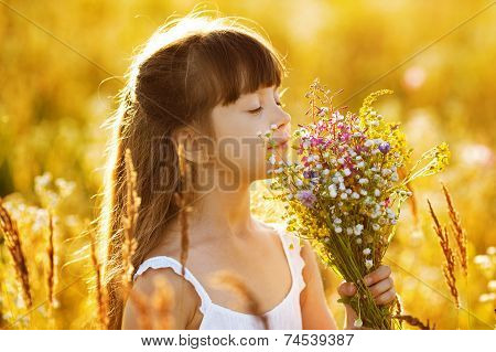 Happy Girl With A Bouquet Of Wild Flowers