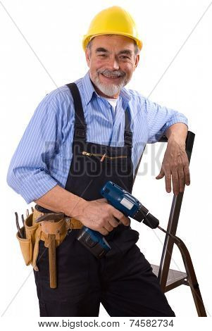 repairman in hardhat with drill and tool belt