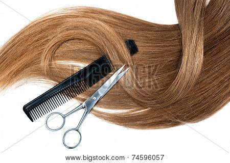 Professional hairdresser scissors  and comb on white background
