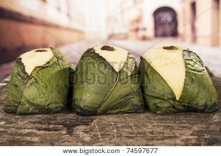 quimbolitos ecuadorian traditional dessert pastry wrapped in achira leaf on wooden table poster