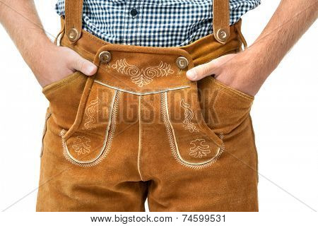 Bavarian man wearing traditional Leather Trousers with hands in pockets