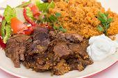 roast lamb kuzu tandir, served with bulgur pilaf and a tossed Turkish salad, all mainstays of Ottoman cuisine poster