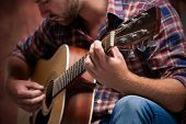 close up of a male musician playing acoustic guitar poster