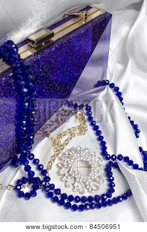 Set Of Women's Accessories On A Silk Background