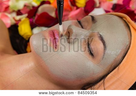 Medical cosmetic procedure. Beautician performs Dermaroller procedure.young beautiful woman having an injection mesotherapy.cosmetic procedures in spa clinic. poster