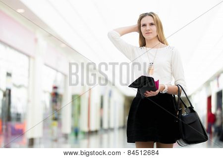 Pensive Young Woman Out Of Money After Shopping Time
