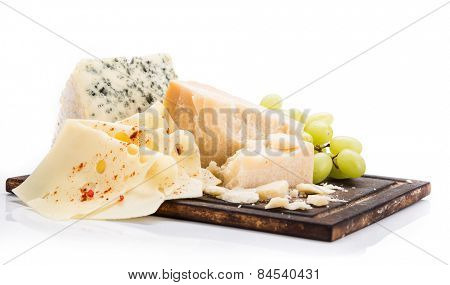 Pieces of various cheeses on white background, close-up.