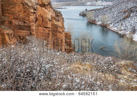 Old sandstone quarry on the shore of Horesetooth Reservoir near Fort Collins, Colorado, winter scenery with snow falling