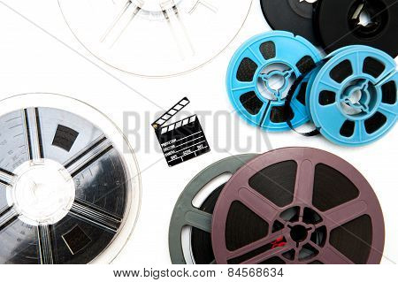 Group Of Vintage 8Mm  Reels Around Little Clapper Board
