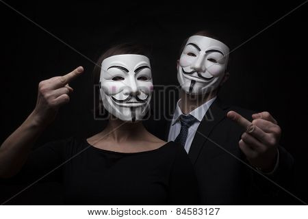 Two Members Of Anonymous Activist Hacker Group With Mask Studio Shot