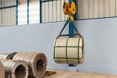 Lifting steel coil by overhead crane, material handling poster