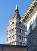 Pistoia (Tuscany Italy): belfry of medieval church of San Giovanni Fuorcivitas and facade of ancient palace poster