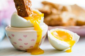 Opened Boiled Blue Duck Egg With Soft Yolk With Toast Soldier Dipped In