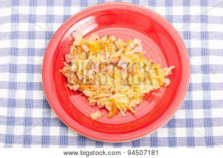 Ham And Cheese Hashbrowns On Red Plate