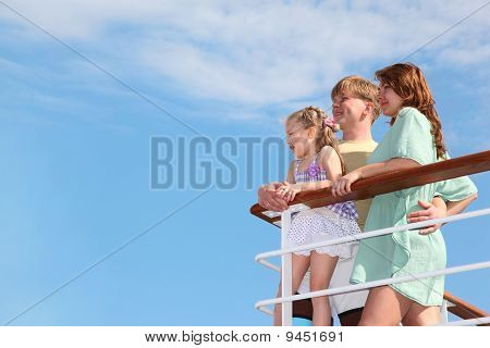 Young Family Rests It At Sea And Looks Far From The Deck