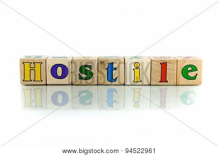 hostile colorful wooden word block on the white background poster