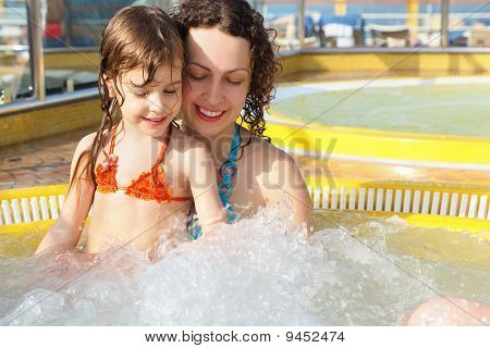 woman with her daughter is relaxing in hot tub on cruise ship.