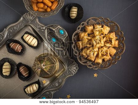Eid celebration food and festive background. View from top.