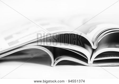 a pile of magazines close up on white background poster