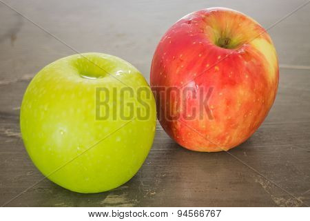 Green And Red Apple On The Table