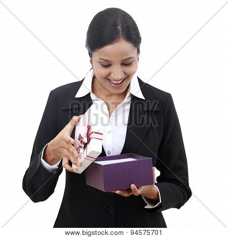Happpy Business Woman Opening A Gift Box